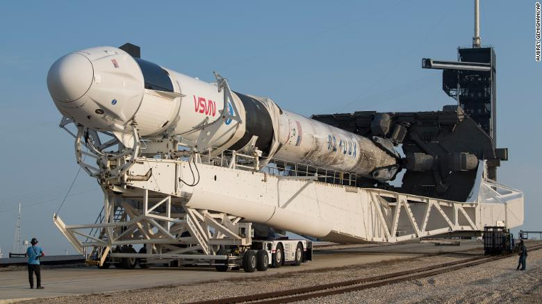 A SpaceX Falcon 9 rocket with the company's Crew Dragon spacecraft is rolled to Launch Complex 39A as preparations continue for the Crew-2 mission at NASA's Kennedy Space Center.