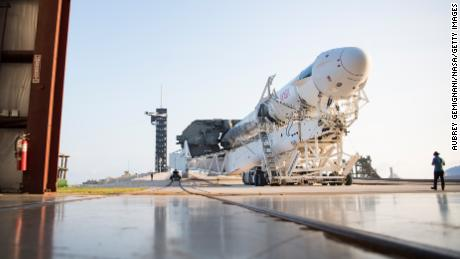 A SpaceX Falcon 9 rocket with the company's Crew Dragon spacecraft onboard is seen as it is rolled out of the horizontal integration facility at Launch Complex 39A as preparations continue for the Crew-2 mission, on April 16, 2021 at NASA's Kennedy Space Center in Cape Canaveral, Florida.