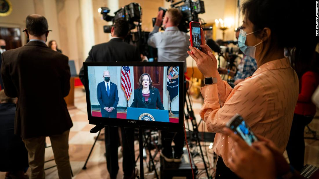 Vice President Kamala Harris is seen on a monitor making remarks about the verdict in Chauvin's trial as President Joe Biden looks on at the White House on April 20.