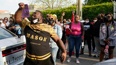 People gather Wednesday outside the A. Parker Midgett Municipal Building in Elizabeth City.