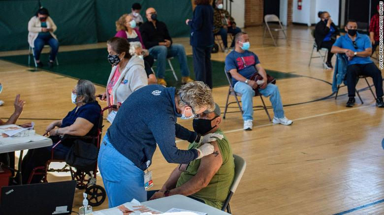 People receive their second dose of the vaccine at a mobile Covid-19 vaccination clinic in Bridgeport, Connecticut, on Tuesday.