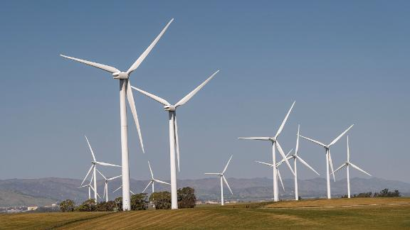 Wind turbines at a wind farm near Highway 12 in Rio Vista, California, U.S., on Tuesday, March 30, 2021. President Biden's $2.25 trillion infrastructure and stimulus blueprint he is set to unveil today, meant to catalyze investments in a clean energy economy and encourage low-emission technology necessary to constrain global warming, would give a 10-year extension to tax credits that have been a boon to wind and other renewable energy projects. Photographer: David Paul Morris/Bloomberg via Getty Images