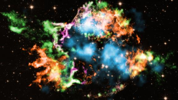 Astronomers used NASA's Chandra X-ray Observatory to study the supernova remnant Cassiopeia A and discovered titanium, shown in light blue, blasting out of it. The colors represent other elements detected, like iron (orange), oxygen (purple), silicon (red) and magnesium (green).