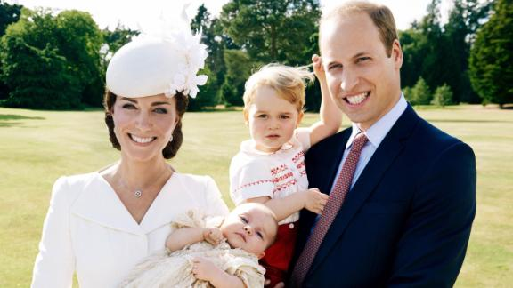 William and Catherine pose with their children at Charlotte's christening in July 2015.