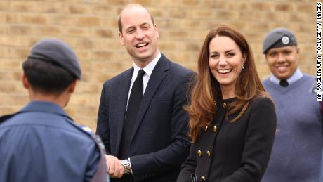 LONDON, ENGLAND -- APRIL 21:  Prince William, Duke of Cambridge and Catherine, Duchess of Cambridge, wearing black as a mark of respect following the Duke of Edinburgh's passing, visit 282 East Ham Squadron, Air Training Corps in East London on April 21, 2021 in London, England. During the visit, the Squadron paid tribute to The Duke of Edinburgh, who served as Air Commodore-in-Chief of the Air Training Corps for 63 years. In 2015, The Duke passed the military patronage to The Duchess of Cambridge who became Honorary Air Commandant. (Photo by Ian Vogler-WPA Pool/Getty Images)