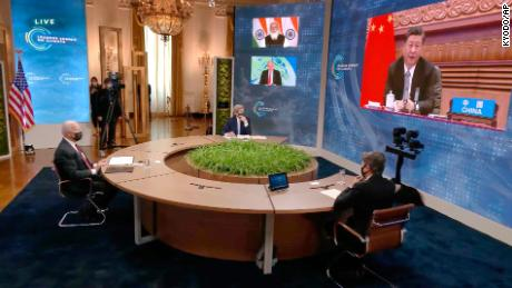 Chinese President Xi Jinping, right (on screen), attending the virtual climate summit with other world leaders on April 22.