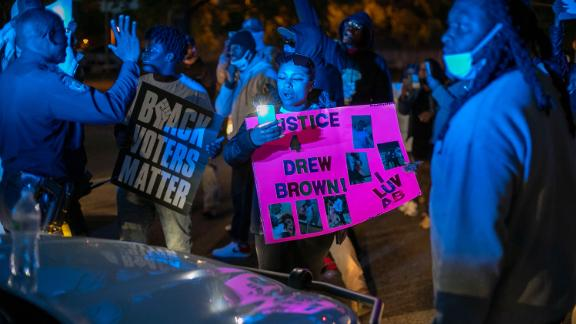 Police try to get  demonstrators to move after they surrounded an Elizabeth City police car on Thursday night.