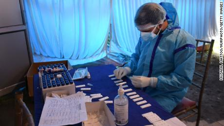 A health worker prepares a Covid-19 test sample at a testing centre in Srinagar, Indian Administered kashmir on 21 April 2021. India reported the highest one day increase with 2,94,115 Covid-19 cases and a record of 2020 new deaths, while as Jammu and Kashmir reported 2204 new cases and 13 new deaths. (Photo by Muzamil Mattoo/NurPhoto via Getty Images)