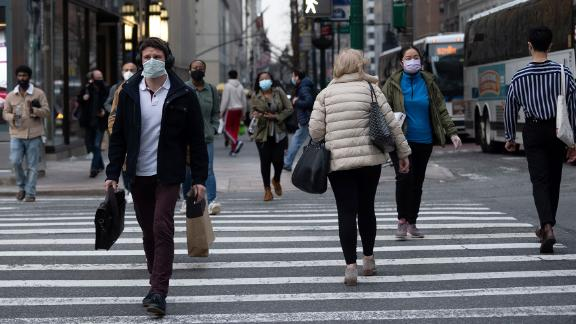 NEW YORK, NEW YORK - MARCH 25: People wearing masks cross the road in Midtown during rush hour on March 25, 2021 in New York City. After undergoing various shutdown orders for the past 12 months the city is currently in phase 4 of its reopening plan, allowing for the reopening of low-risk outdoor activities, movie and television productions, indoor dining as well as the opening of movie theaters, all with capacity restrictions. (Photo by Alexi Rosenfeld/Getty Images)