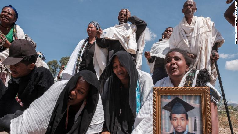 Tigrayans grieve by a mass grave in the city of Wukro, north of Mekele, on February 28, 2021.