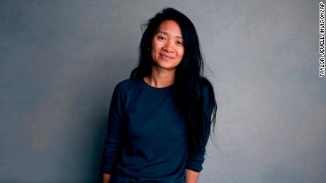 """FILE - Chloe Zhao poses for a portrait during the Sundance Film Festival in Park City, Utah on Jan. 22, 2018. Zhao was nominated for a Golden Globe for best director on Wednesday, Feb. 3, 2021 for her work on """"Nomadland."""" """"Nomadland"""" has won four prizes, including best picture, at the British Academy Film Awards on Sunday, April 11, 2021. The film's director, Chloe Zhao, became only the second woman to win the best director trophy, and star Frances McDormand was named best actress. """"Nomadland"""" also took the cinematography prize on Sunday. Emerald Fennell's revenge comedy """"Promising Young Woman"""" was named best British film, while the best actor trophy went to 83-year-old Anthony Hopkins for playing a man grappling with dementia in """"The Father."""" An event that was criticized in the recent past with the label #BAFTAsSoWhite rewarded a diverse group of talents, during a pandemic-curbed ceremony at London's Royal Albert Hall. (Photo by Taylor Jewell/Invision/AP, File)"""