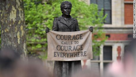 The statue of women's rights campaigner Millicent Fawcett is unveiled in April 2018. It is the only statue of a woman, among 11 men, in London's Parliament Square.