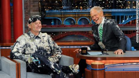 "Bill Murray jumps out of a cake during his final appearance on the ""Late Show with David Letterman"" in 2015."