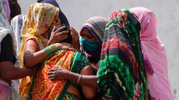 Relatives of a Covid-19 victim mourn for their loved one outside a government hospital in Ahmedabad on April 17.