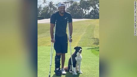 Tiger Woods on crutches in the first photo he's posted online of himself since February's car accident.