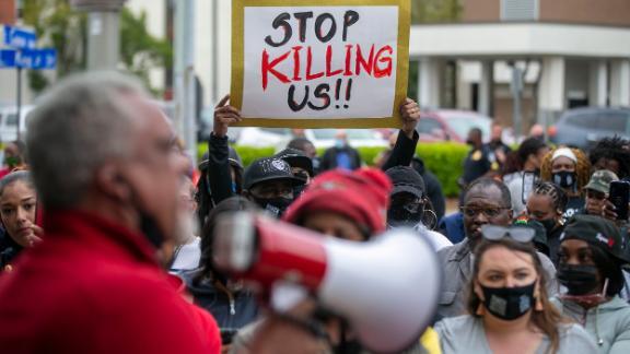 Kirk Rivers addresses demonstrators outside City Hall in Elizabeth City on Friday.