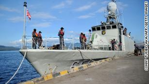 An Indonesian Navy patrol boat prepares to leave a naval base in Banyuwangi, East Java province, on Saturday, as the military continues search operations off the coast of Bali for the missing submarine.