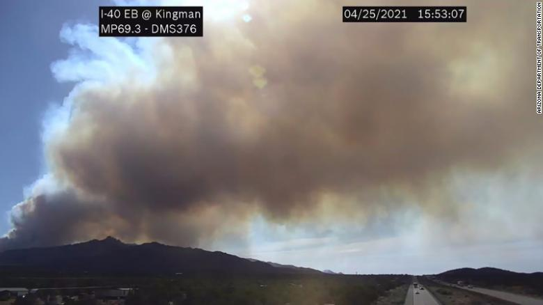 An Arizona wildfire that's 'raging out of control' prompts evacuation orders for about 200 homes