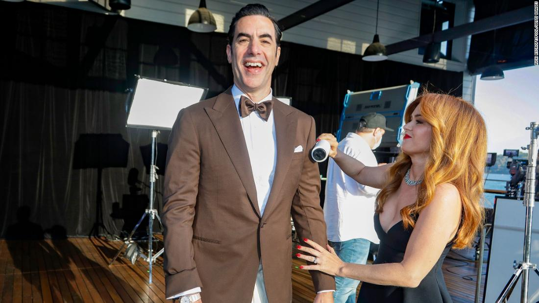 Actor Sacha Baron Cohen is cleaned up by his wife, Isla Fisher. They appeared on the show from Sydney.