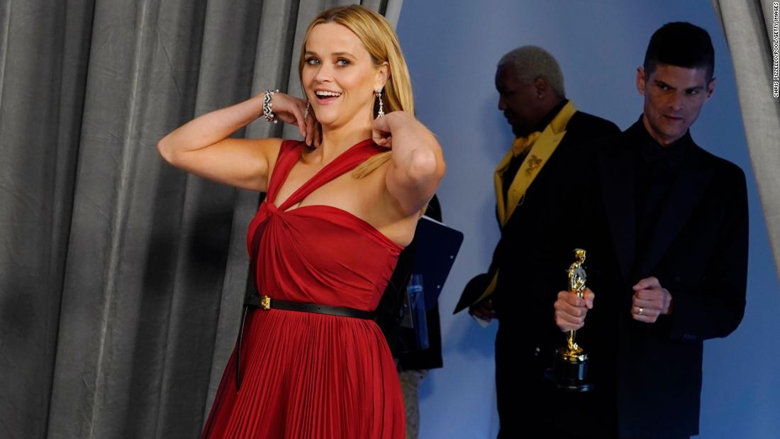 Actress Reese Witherspoon enters the Oscars press room. She was one of the award presenters.