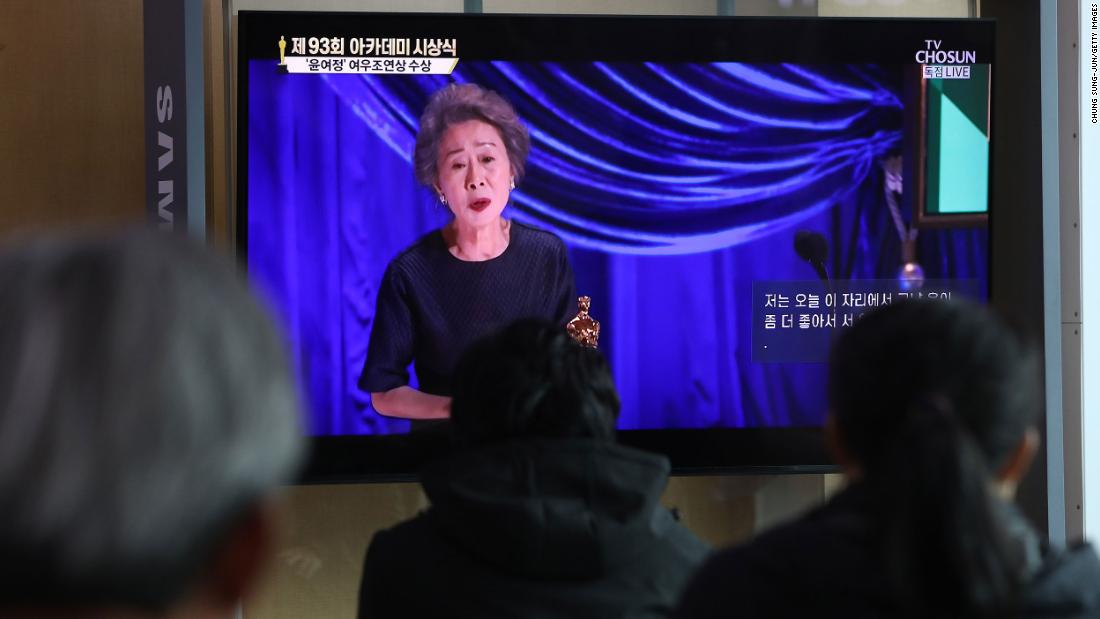 People watch Youn's acceptance speech from a railway station in Seoul, South Korea. She's the first South Korean actress to win an Oscar.
