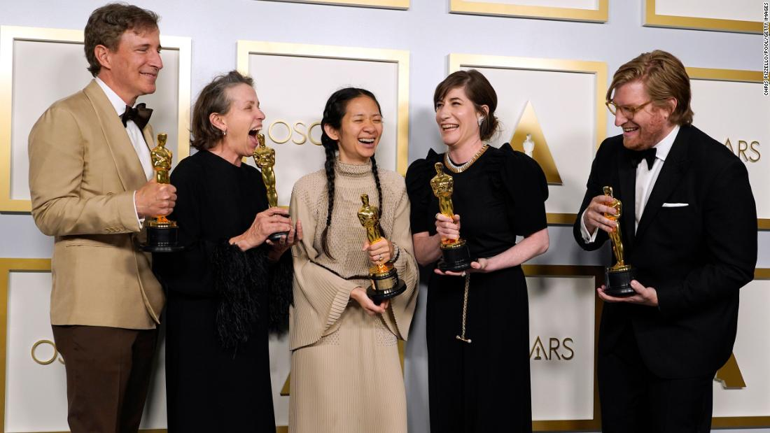 "From left, producer Peter Spears, actress Frances McDormand, director Chloé Zhao, producer Mollye Asher and producer Dan Janvey pose with their Oscars in the press room after their film ""Nomadland"" won best picture on Sunday, April 25."
