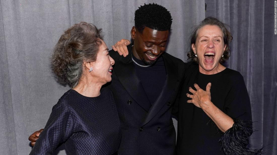 "A trio of Oscar winners -- from left, Yuh-jung Youn, Daniel Kaluuya and Frances McDormand -- pose together in the press room. Youn won best supporting actress for her role in ""Minari."" Kaluuya won best supporting actor for his role in ""Judas and the Black Messiah."" And McDormand won best actress for ""Nomadland."""