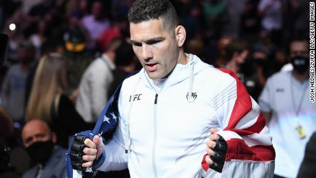 Weidman walks out towards the Octagon prior to facing Hall.