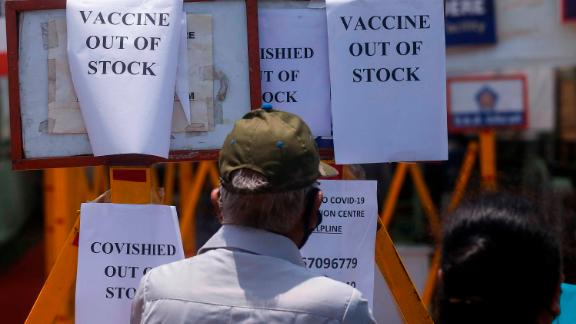 Signs inform people that a vaccination center in Mumbai was out of vaccines on April 20.