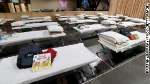 Sleeping quarters set up inside Exhibit Hall B for migrant children are shown during a tour of the Long Beach Convention Center on April 22, 2021.