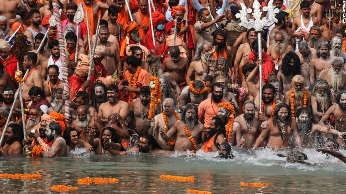 "Hindu holy men wade into the Ganges River during the Kumbh Mela religious festival on April 12. People also packed the streets of Haridwar for what is the largest religious pilgrimage on Earth, and <a href=""https://edition.cnn.com/2021/04/12/india/india-covid-kumbh-mela-crowd-intl-hnk-scli/index.html"" target=""_blank"">the massive crowds created concern.</a>"