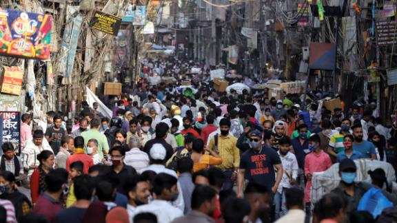 Social distancing was not easy to achieve as people walked through a busy market in Old Delhi on March 27.
