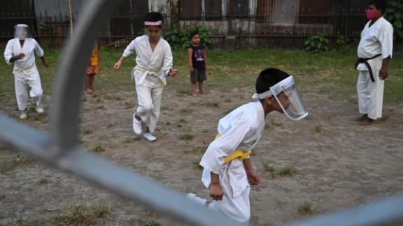 Children wear face shields at a martial-arts class in Kolkata on April 5.