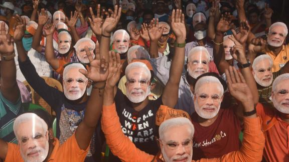 Supporters of the Bharatiya Janata Party wear masks of Prime Minister Narendra Modi during an election rally in Sonarpur on April 3.