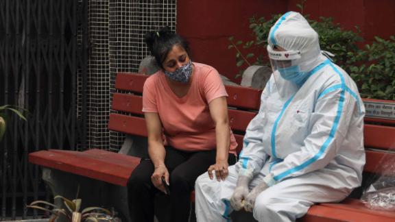A relative of a Covid-19 victim breaks down during a cremation in New Delhi on April 20.