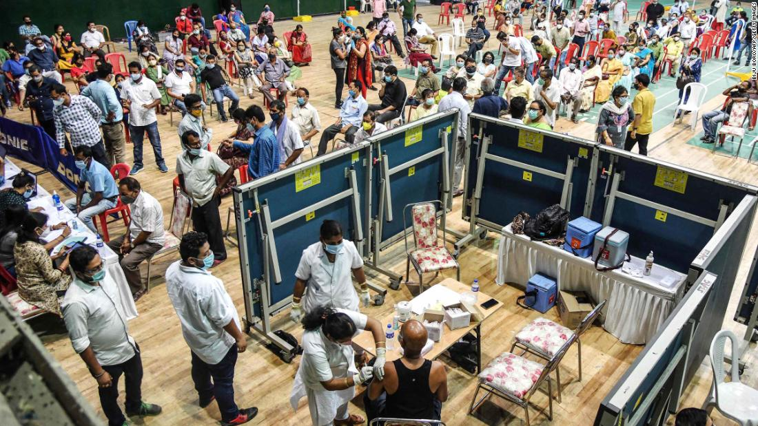 People line up for vaccines at an indoor stadium in Guwahati on April 22.
