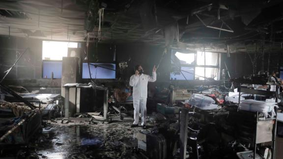A man inspects an intensive-care ward after a fire broke out at a Covid-19 hospital in Virar on April 23. At least 13 Covid-19 patients were killed in the fire.