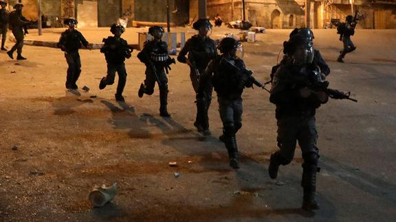 Israeli forces patrol a street during clashes with Palestinian youth in Hebron on April 25.