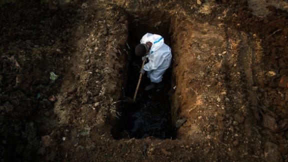 A worker digs a grave for a Covid-19 victim in Guwahati on April 25.