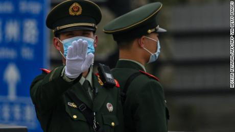 On April 16, 2021, a Chinese paramilitary policeman gestured on the Bund promenade along the Huangpu River in Shanghai.