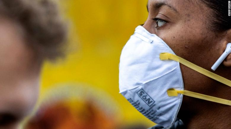 Ditching masks may feel strange to some people after a year of wearing them, one expert says.