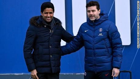 PSG president Nasser Al Khelaïfi poses with head coach Mauricio Pochettino, who was appointed earlier this season.