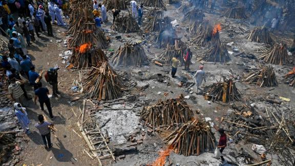 Multiple funeral pyres burn in New Delhi on April 27.