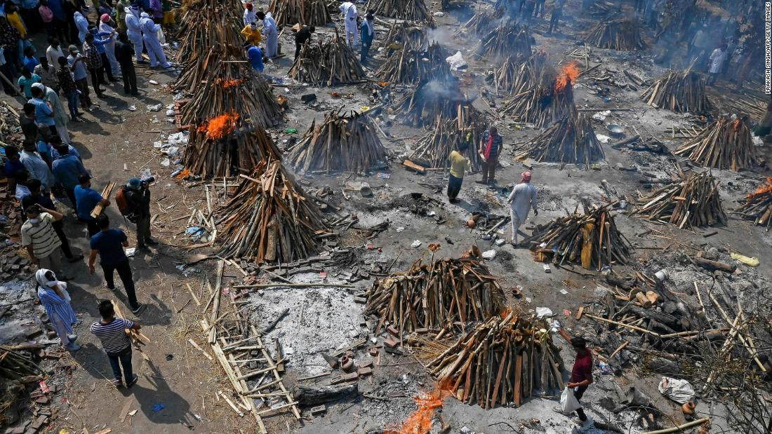 Multiple funeral pyres burn in New Delhi on April 27.