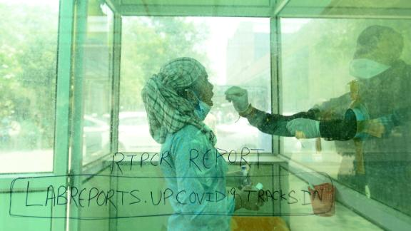A health worker administers a Covid-19 test at a hospital in Noida on April 26.