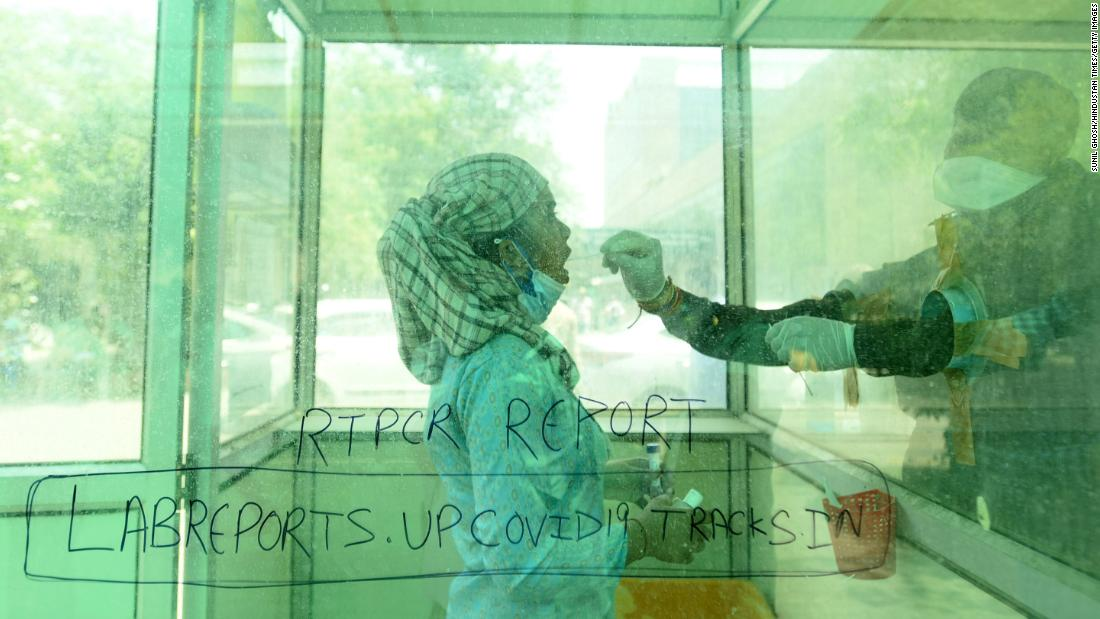 A health worker administers a Covid-19 test at a hospital in Noida on Monday, April 26.