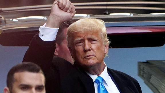 FILE PHOTO: Former U.S. President Donald Trump acknowledges people as he gets in his SUV outside Trump Tower in the Manhattan borough of New York City, New York, U.S., March 9, 2021. REUTERS/Carlo Allegri