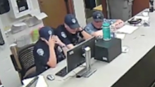 Loveland, Colorado, police officers watch body camera footage of Karen Garner's arrest.