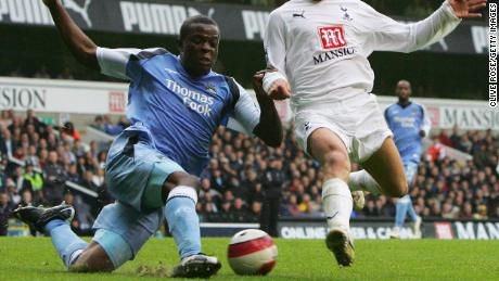 Onuoha battles for the ball in a game between Manchester City and Tottenham.