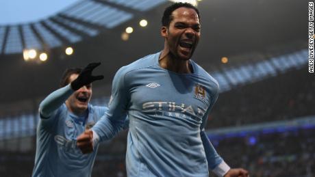 Lescott celebrates after scoring the second goal during the Premier League match against Aston Villa.